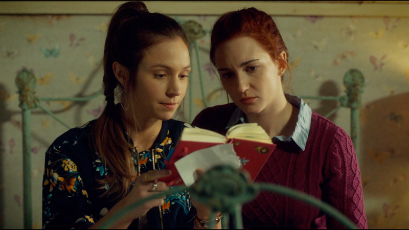 Waverly and Nicole sit on the bed reading Willa's diary and it's VERY CUTE