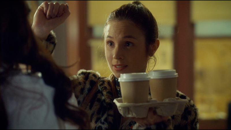 Waverly blocks Wynonna's almost-stab while holding a tray of coffee