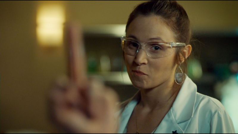Waverly smirks as Wynonna puts up her middle finger as content for a note to leave Lucado