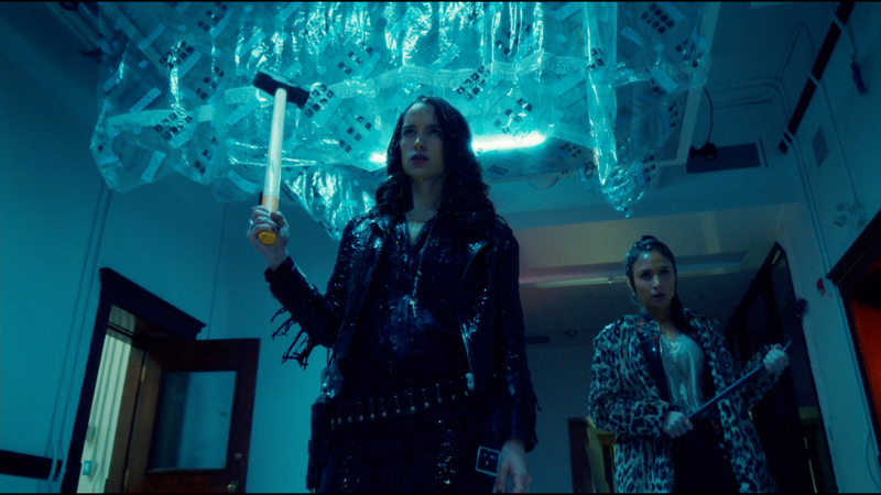Wynonna and her sledgehammer and Waverly and her crow bar are covered in goo and swagging down the hall