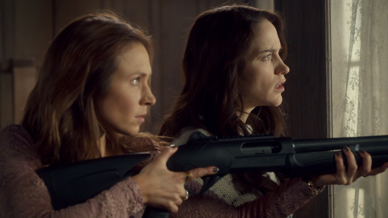 Wynonna and Waverly in profile, Waverly with her big-ass gun
