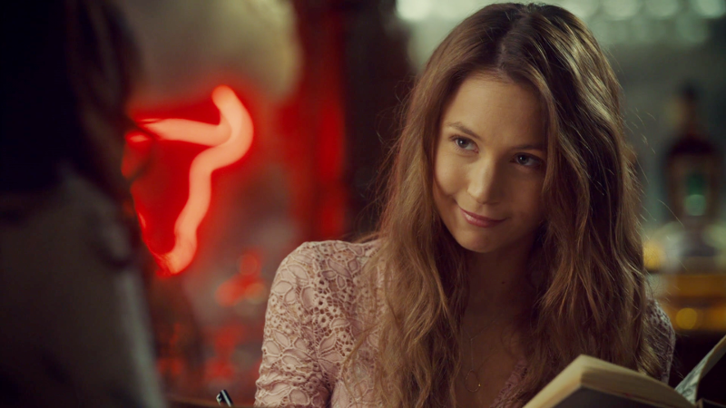 Waverly is reading an old book and smirking and looking cute af