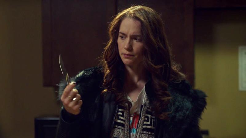 Wynonna looks at Waverly's stolen knife, perplexed