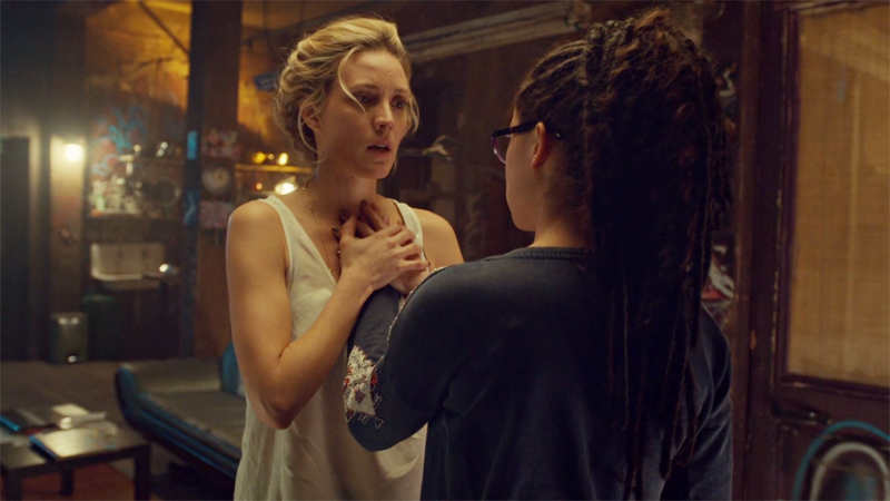 Delphine holds Cosima's hand over her heart