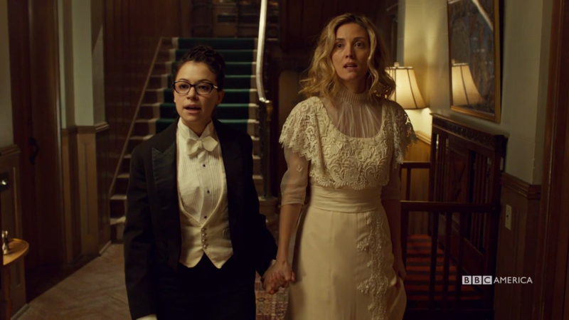 Cosima is in a full tux and Delphine is in a vintage wedding gown