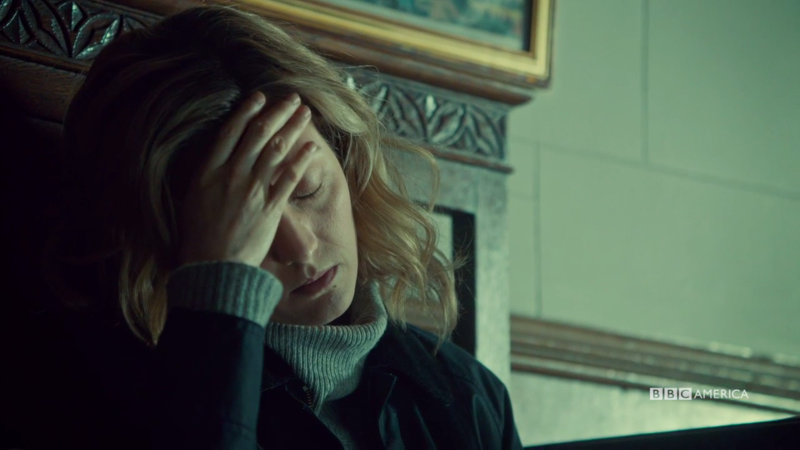 Delphine holds her head in her hand