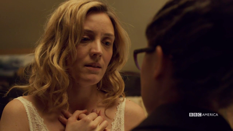Delphine holds COsima's hand over her heart again