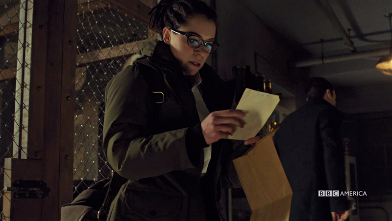 Cosima looks at a piece of paper and is shocked by its contents