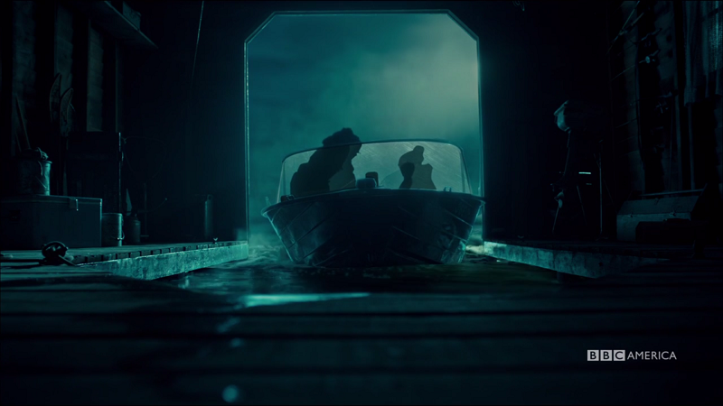Cosima and Charlotte's sillohuttes are all we see as the boat pulls out into the night