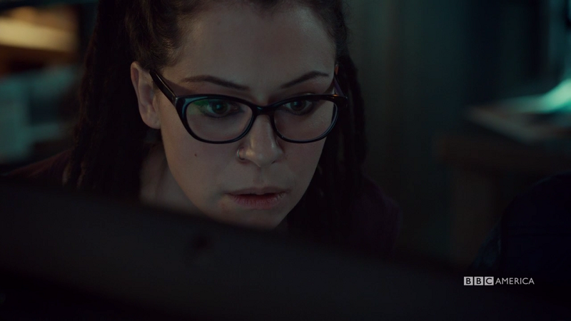 Cosima looks surprised at her computer