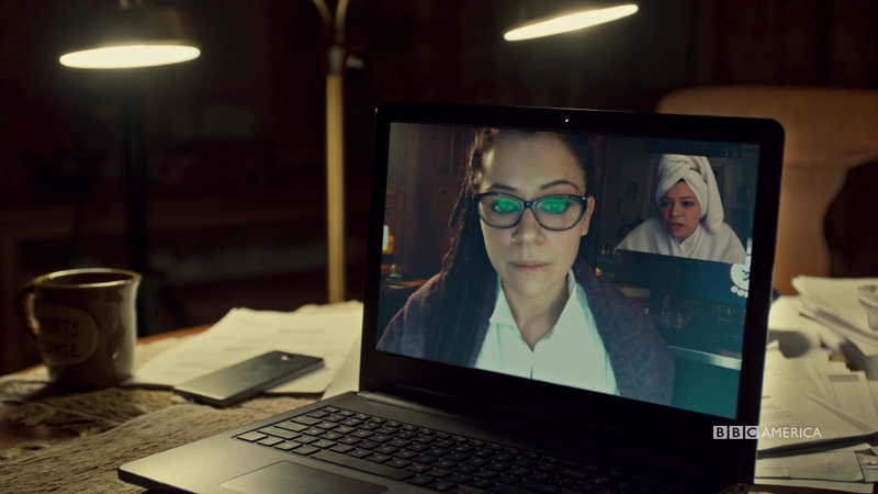 Sarah's screens shows Cosima and Alison and Ali is in a towel