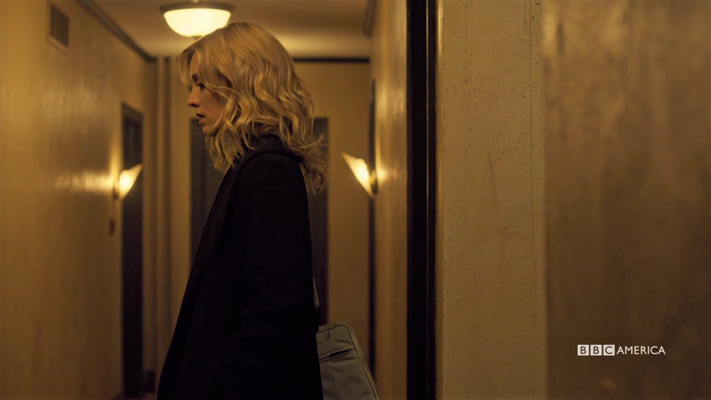Delphine stands in the hallway looking great and a little shady but it's okay I love her anyway