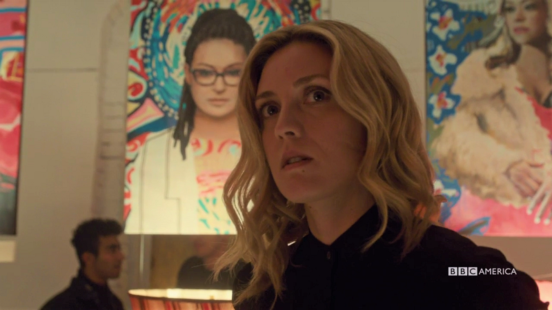 Delphine looks a little alarmed and the painting of Cosima is over her shoulder