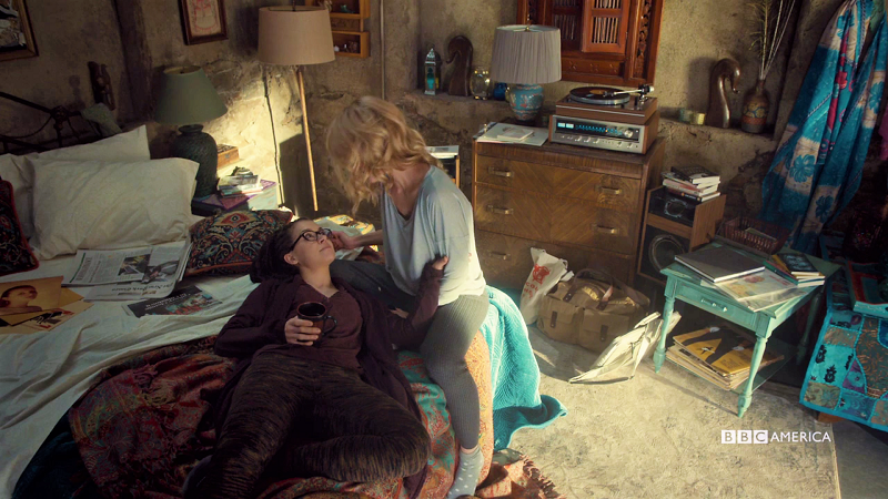 Cosima lays in Delphine's lap and they're cute and they love each other
