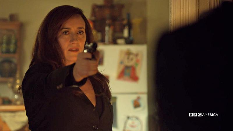 Mrs. S points her gun at Ferdinand