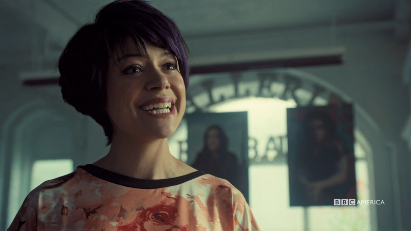 Alison smiles intensely