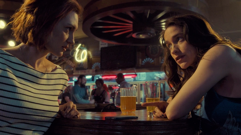 Wynonna and Nicole are deep in conversation at the bar