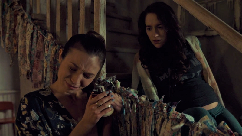 Wynonan looks on worriedly as Waverly cries suddenly