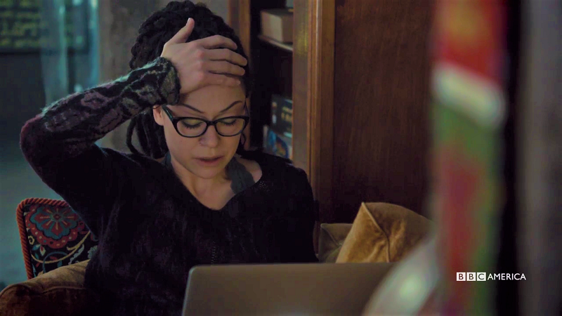 Cosima looks upset at her laptop
