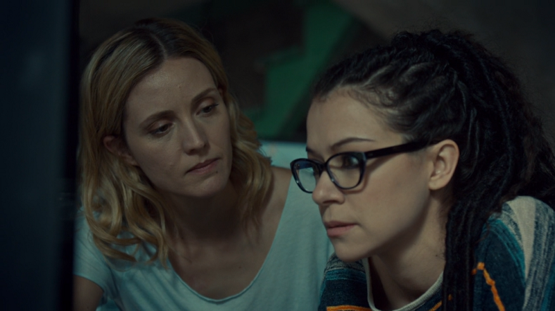 Delphine and Cosima look serious but I'm smiling