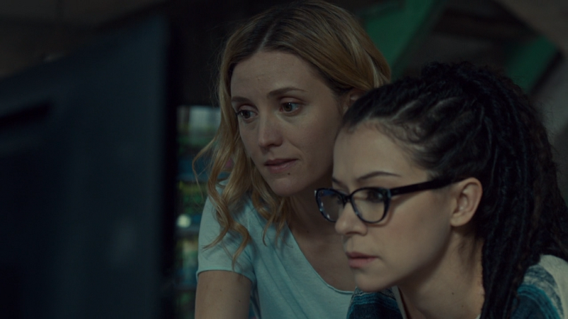 Delphine smiles and Cosima looks a little overwhelmed tbh