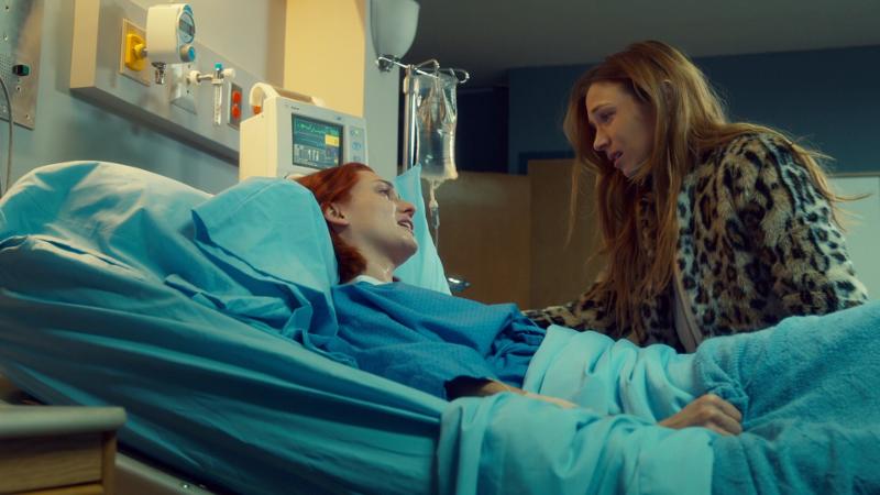 Waverly sits on Nicole's hospital bed