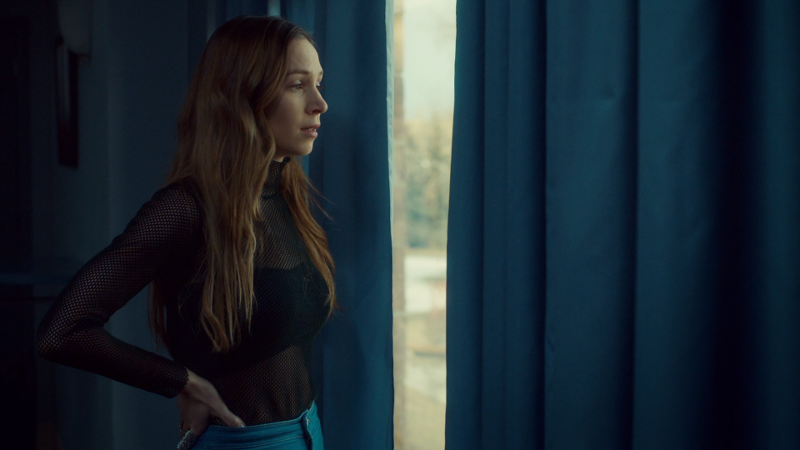 Waverly looks out a window