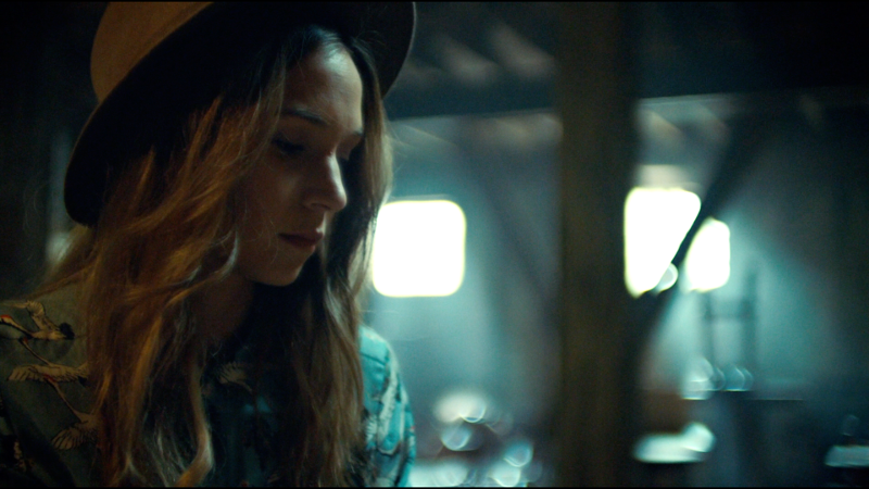 Waverly and her cute hat look down at her box of Earp info