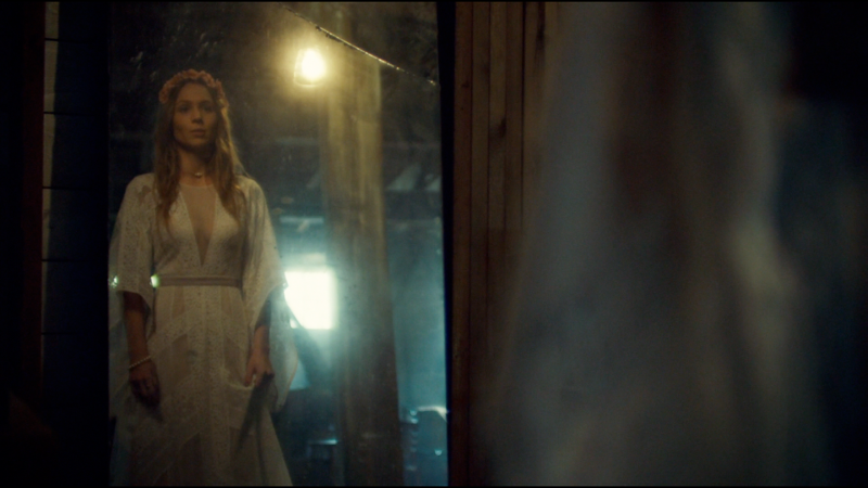 Waverly looks in the mirror wearing her mother's wedding dress