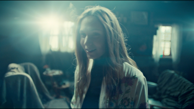 Waverly smiles fondly as she remembers Wynonna