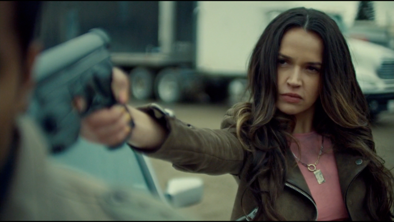 Rosita points a gun at Jeremy looking like a bamf