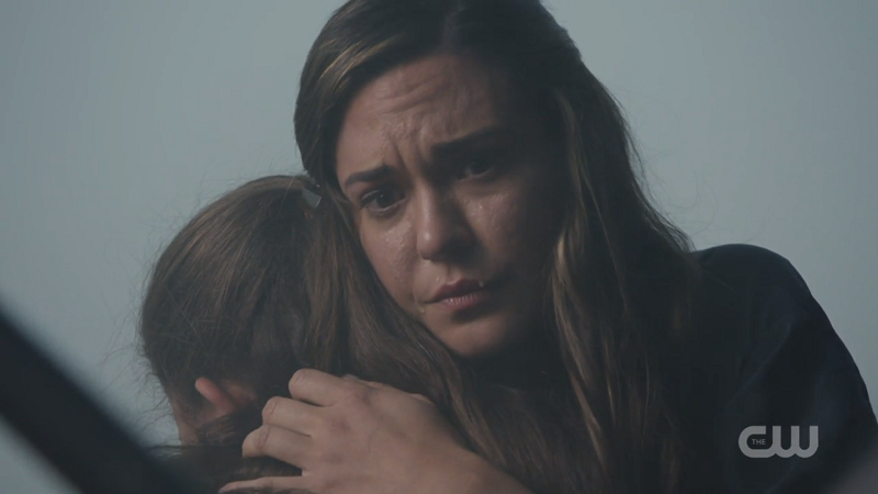 Sam holds her daughter after saving her