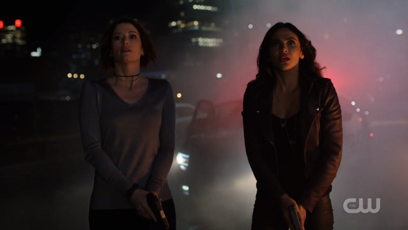 Maggie and Alex look up to the sky as Supergirl flies away