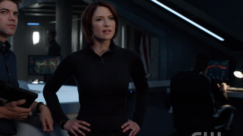 Alex stands with her hands on her hips