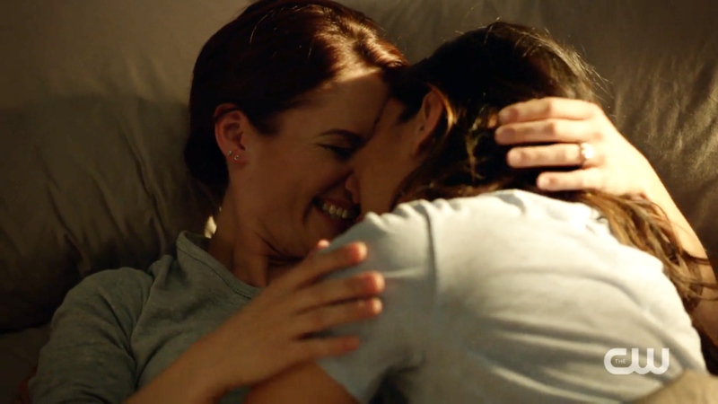 Alex and Maggie are in bed, kissing and giggling