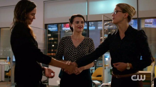 Lena heart-eyes at Kara while Kara shakes Sam's hand