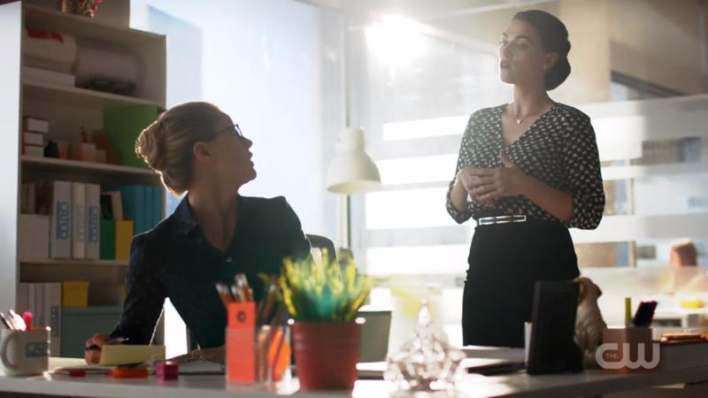 Lena looms over Kara's desk
