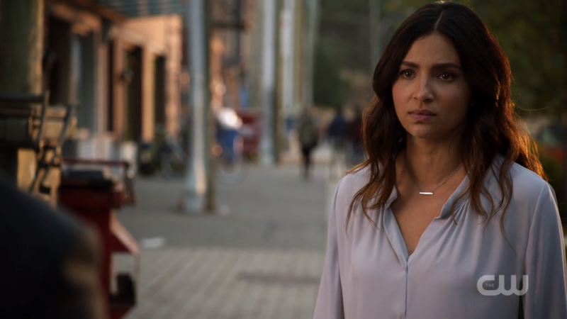 Maggie looks sadly while her dad yells stupidly