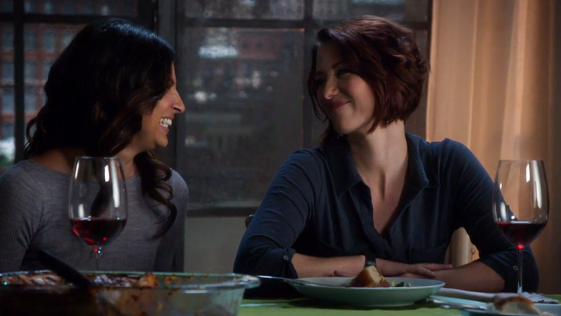 Maggie and Alex laugh with each other