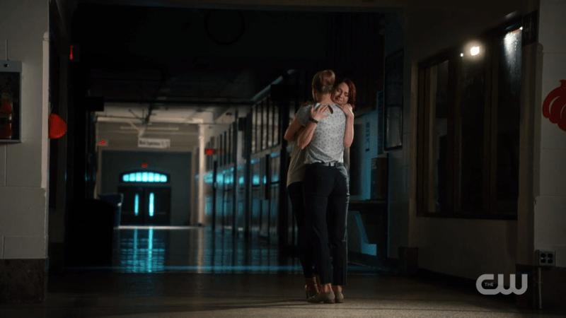 Kara hugs a devastated Alex
