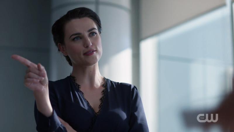 Lena points submissively to Kara