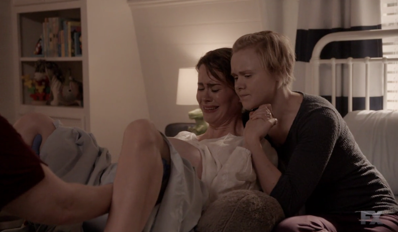 Ivy holds Ally while she gives birth