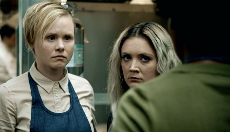 Allison Pill as Ivy in American Horror Story: Cult. With a teenage female character in a kitchen.