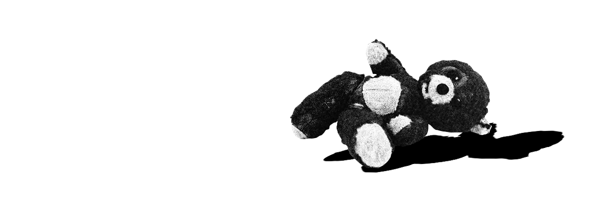 old teddy bear lying on the ground