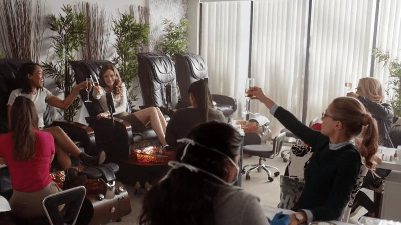 Iris, Caitlin, Felicity and Kara raise their glasses of champagne