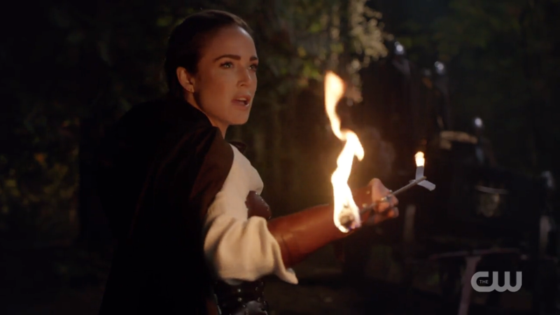 Sara Lance catches a flaming arrow