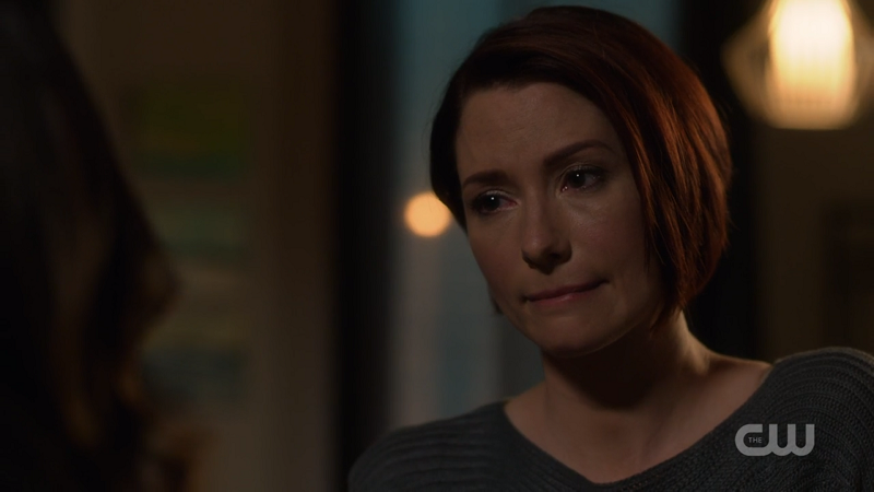 Alex looks sadly at Maggie