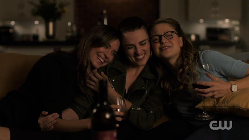 Sam, Lena and Kara snuggle on the couch