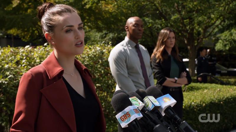 Lena gives a speech at a podium