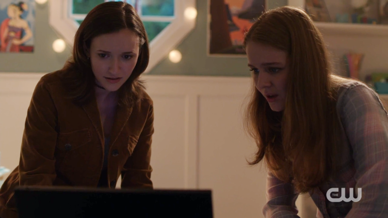 Alex and Kara look intensely at their computer